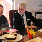 Board member, Terry Wilson joins the the people sharing at the new Identitywa house and their support workers for a celebratory afternoon tea.