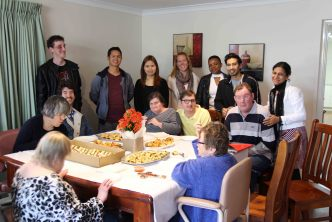 Housemates and staff enjoying Afternoon Tea at the Blessing of their home.