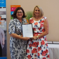 Centacare graduate, Julie Davids, being presented with her Certificate in Individual Support from Identitywa CEO, Marina Re, presenting