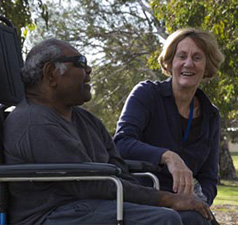 Man and woman laughing in park setting