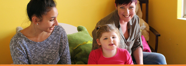 Sadie with her mum, Lynley (R) and support worker, Cam (L).
