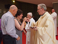 Genevieve receives Communion from Bishop Sproxton