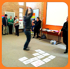 Staff jumping for joy at completing activity