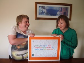 Harry and Bettina holding the pledges turned artwork.
