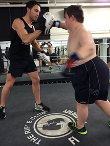 Dale boxing with trainer in the ring