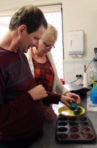 Scott and mum, Jan, cooking muffins.