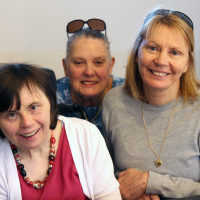 Lisa loves when her sisters come to visit her at her Identitywa shared house.