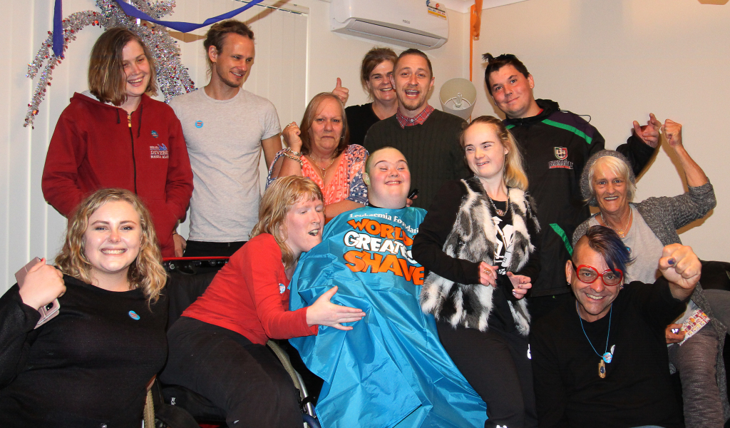 Dale's friends and family celebrate his fundraising success...and new haircut!