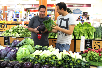Ben and Lee stocking up on  fruit and vegetables for the week.