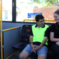 Simon practises traveling to work with his support worker.