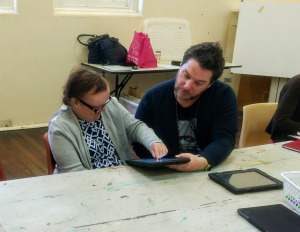 Mandy creating her artwork with one of the DADAA mentors