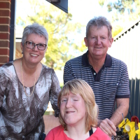 Ellen with her mum and dad