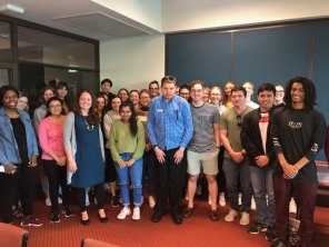 Chris (centre) with Notre Dame students