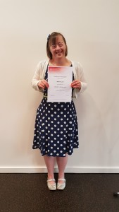 Bettina with her graduation certificate